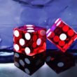 two red dices on a table