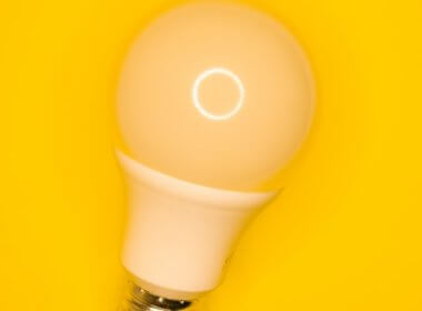 light bulb against yellow background